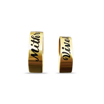Gold ring with name engraved on top of it.