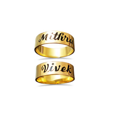 Ring in gold with couple name on top of it.