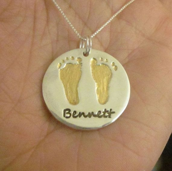 Kid's foot print engraved on the gold pendant