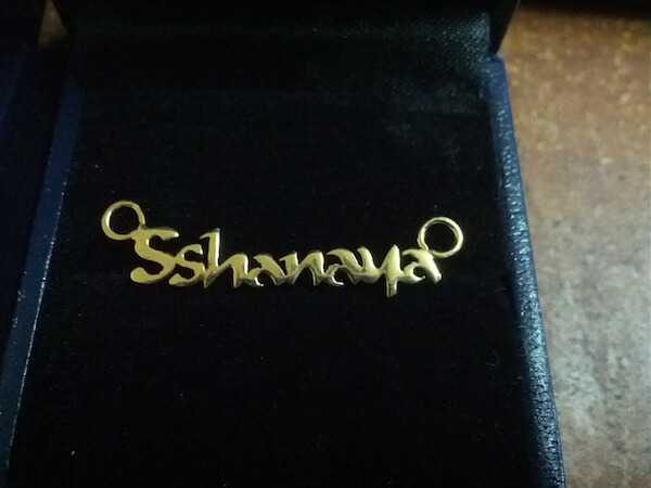 gold pendant with person's name on it - SShanaya