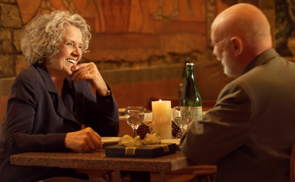 lifestyle photo of an elderly caucasian couple as they celebrate an anniversary at a restaurant