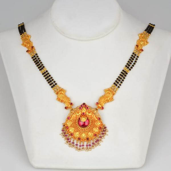 Gold Mangalsutra designs with gemstones