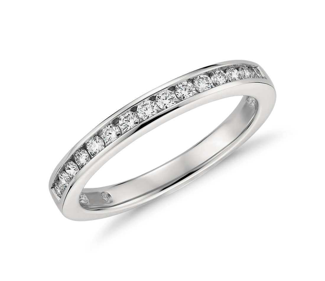 Channel setting engagement rings