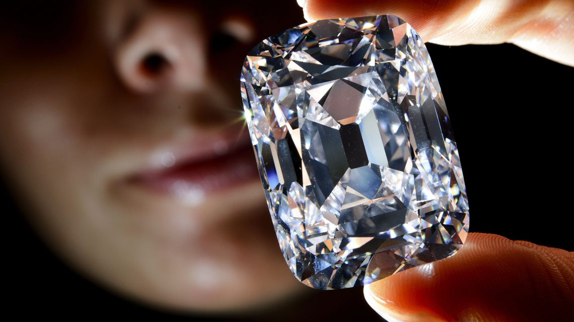 "TOPSHOTS  A model holds the ""Archduke Joseph"" historial diamond on October 3, 2012  during a Christie's auction preview in Geneva. Once  part of the collection of the Archduke Joseph of Austria (1872-1962), the D color diamond, weighing 76,02 carats and mined at the legendary Indian Golkonda mine, is expected to reach between 15 million and 20 million US dollars at an auction on November 13 in Geneva.   AFP PHOTO / FABRICE COFFRINI"