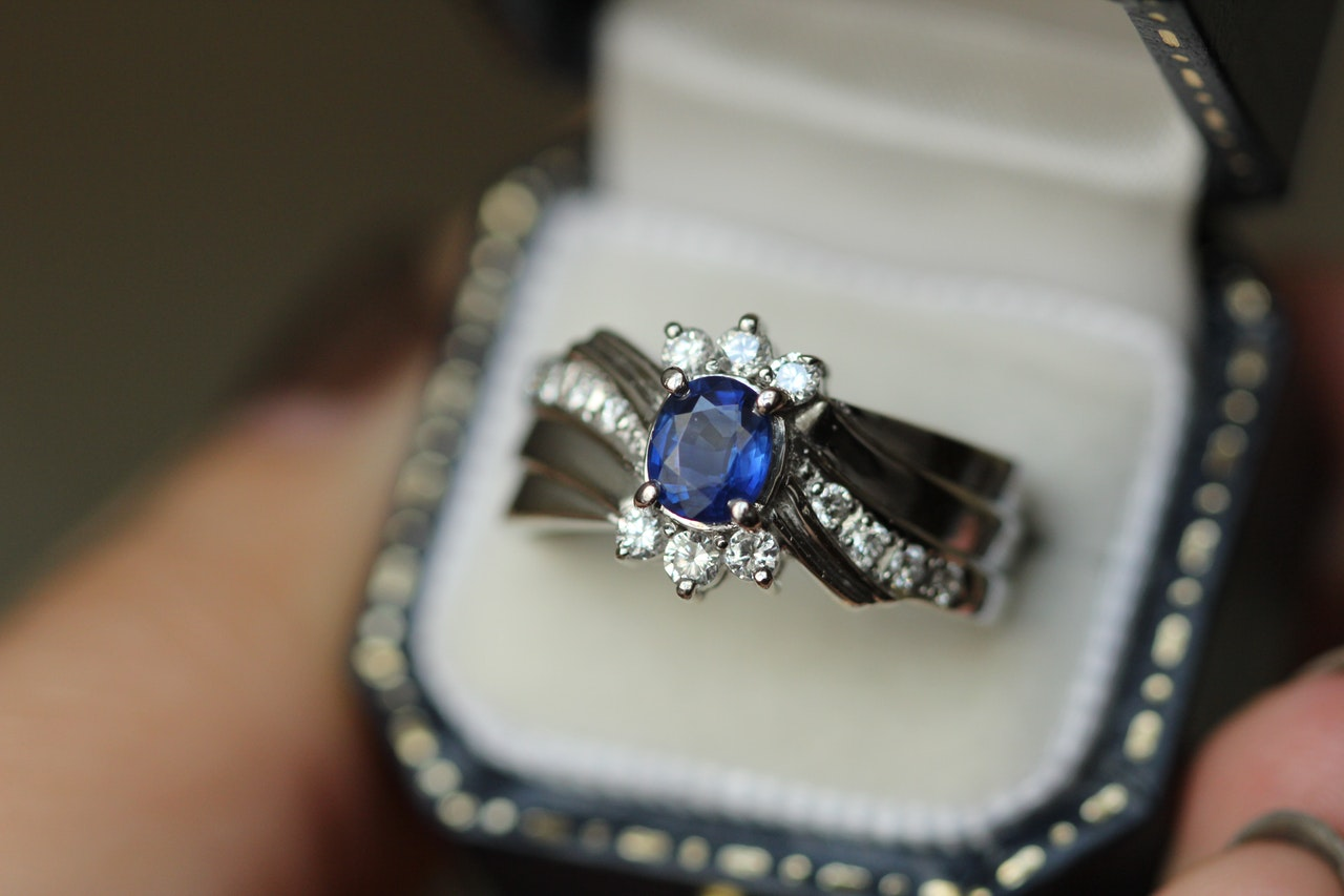 A beautiful custom-made engagement ring with a blue stone