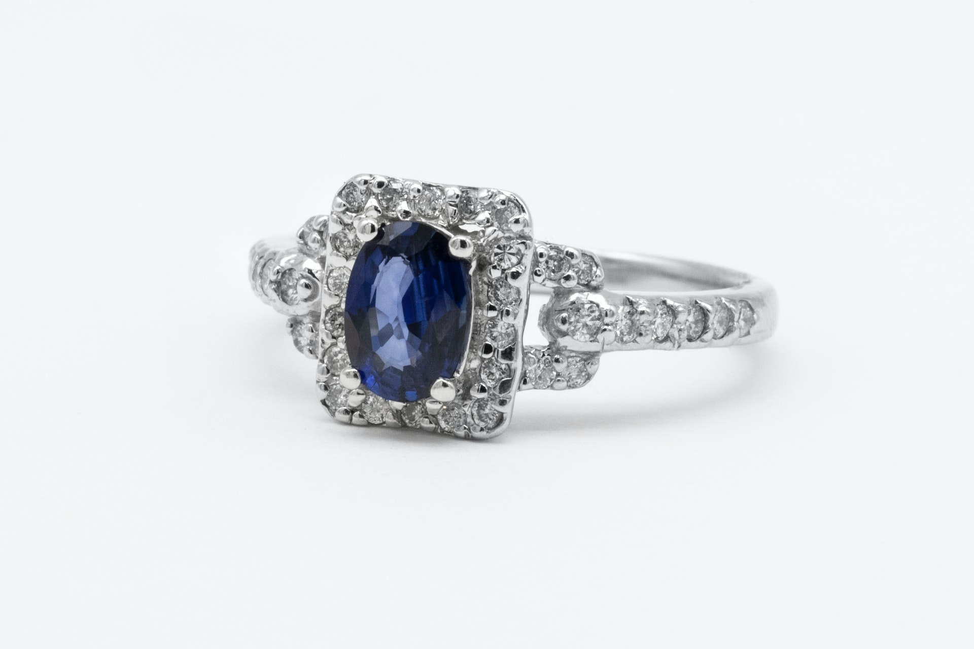 An engagement ring with a blue stone