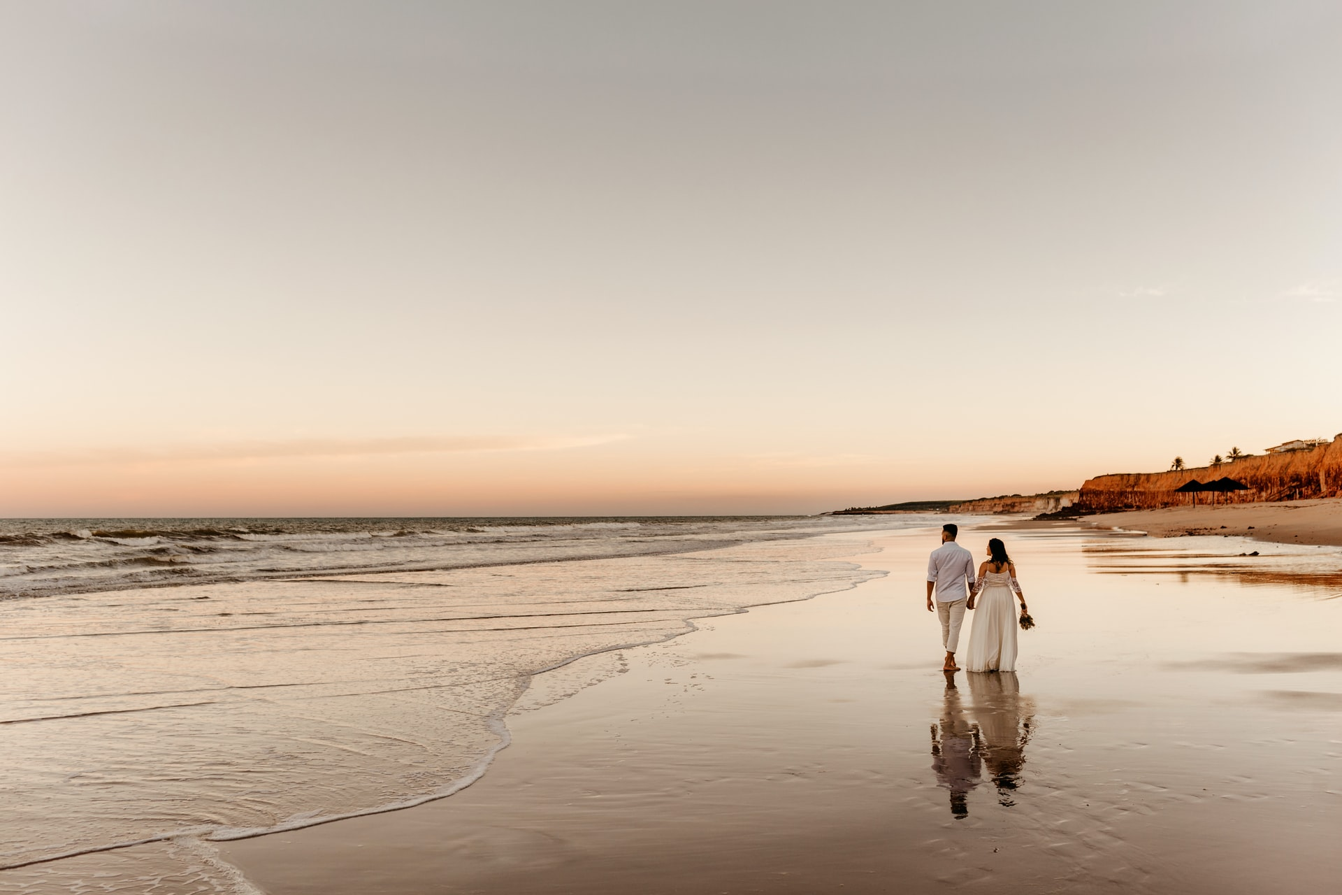 Two people walking on a beach